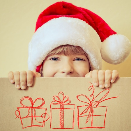 happy child opening presents, tips for buying safe toys for children, persona injury lawyer orange county